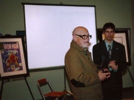 Gene being awarded Charles Schulz Award Comic Art